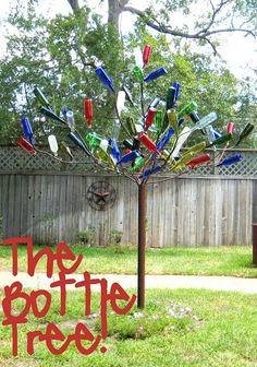 This looks like my bottle tree on steroids. The V Spot: DIY Wine Bottle Crafts Wine Tree, Wine Bottle Trees, Wine Bottle Corks, Bottle Cap Crafts, Diy Bottle, Metal Yard Art, Bottle Garden, Tree Crafts, Cork Crafts