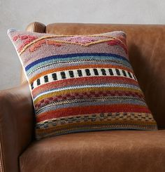 so boho. Inspired by our love of Peruvian textiles, this multi-pattern pillow stitches together a traditional pattern in warm earthy tones on a field of soft wool and cotton. Brings a traveled vibe to any space. Reverses to solid ivory. Do the math: CB2 low prices include a pillow insert in your choice of plush feather down or lofty down alternative (a rare thing indeed).