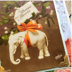 Excited to share the latest addition to my #etsy shop: Vintage French New Year Postcard handmade vintage New Year greeting card upcycled Bonne Annee elephant card mistletoe https://etsy.me/2JrfyJ0 #papergoods #brown #orange #vintage #frenchnewyear #french #newyear #new