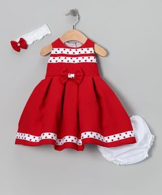 Complete with a lacy headband, silky-soft diaper cover and fancy frock that snaps in back, this charming ensemble makes getting dressed oh-so easy. Plus the pretty bow on the dress' front is attached with a safety pin and can be easily removed for machine washing. Includes dress, headband, diaper cover and pin100% cotton...