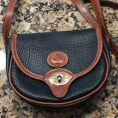 Dooney & Bourke small crossbody bag Vintage black pebbled leather with brown leather trim.   Excellent condition.   032315 Dooney & Bourke Bags Crossbody Bags