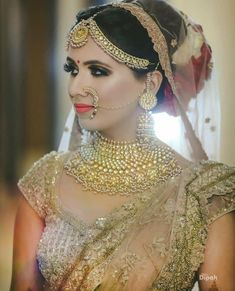 When it comes to an Indian wedding, gold naths, or nose rings play a huge role to the bridal attire. Even in this modern age, gold naths add a bit of traditionalism and style to the bride's apparel. Bridal Hairstyle Indian Wedding, Indian Bridal Sarees, Indian Bridal Fashion, Bridal Lehenga, Hair Wedding, Bridal Outfits, Bridal Dresses, Bridal Photoshoot, Bride Look