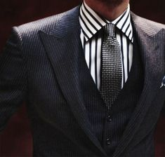 Shop this look on Lookastic: http://lookastic.com/men/looks/white-and-black-vertical-striped-dress-shirt-black-and-white-polka-dot-tie-charcoal-vertical-striped-three-piece-suit/9029 — White and Black Vertical Striped Dress Shirt — Black and White Polka Dot Tie — Charcoal Vertical Striped Three Piece Suit