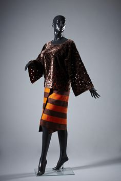 Outfit by Elizabeth Wuraloa Ojo consisting of a Buba top and Skirt/Short Wrapper.  Displayed at the exhibition Fashion Cities Africa, Brighton Museum & Art Gallery April 2016-January 2017.  Professional images of outfits, clothes and accessories, mostly arranged in their original 'looks' from Fashion Cities Africa exhibition, 2016-2017, taken by Tessa Hallmann on our behalf.