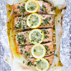 A quick and easy baked salmon recipe that is coated in a butter, lemon and basil sauce, wrapped in foil or parchment paper and then cooked in the oven. It is the best healthy, easy, and low-carb seafo Baked Salmon Recipes, Fish Recipes, Seafood Recipes, Dinner Recipes, Cooking Recipes, Paleo Dinner, Healthy Recipes, Keto Recipes, Salmon Recipe Videos