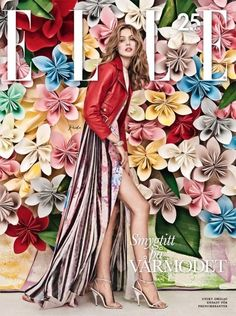I love the paper flowers in the background. Cover for Elle Sweden, 2013.