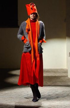 Daniela Gregis - the scarlet and orange really sing against the neutral greys.