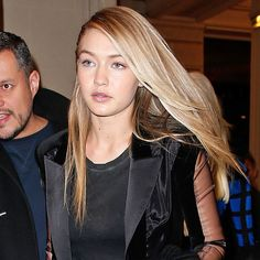 """How To Maintain Gigi's Golden Blonde Color - """"If your hair tends to turn brassy, use a purple shampoo (like Shimmer Lights) once a week which will help control the warmth. As for swimming in the pool, always get your hair wet with non-chlorinated water first. Think of the hair as a sponge—when it's dry, it will absorb whatever you put into it first. I recommend using Sally Hershberger's Keratin Rx to detangle hair after a day out and about to keep it looking fresh.""""Photo: Getty Images"""