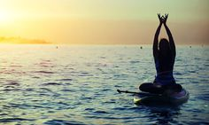 Practice Stand-Up Paddle Yoga surrounded by the beauty of Ibiza's natural landscapes. #CelebrityCruises #ShoreExcursions