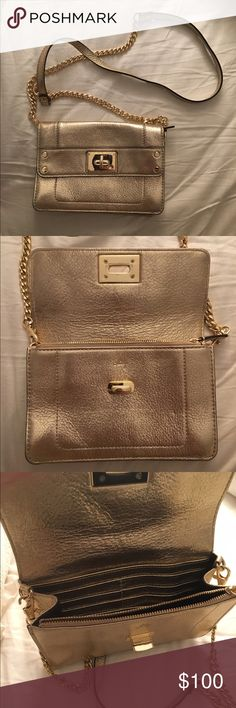 """MILLY Gold Chain Cross Body Bag Measurements: 2""""L x 6""""H x 7.5""""W                            Gold Chain Crossbody Bag Gold hardware Leather 1 inner zipper pocket 8 credit card slots Fold over opening w/ clasp Removable strap Strap drop 23.5"""" or less Milly Bags Crossbody Bags"""