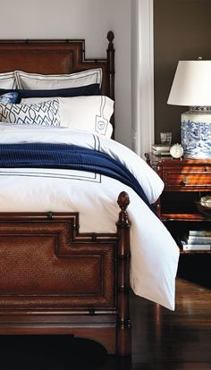 Regency style beds first adopted a faux-bamboo motif in the late 18th century when England opened trade with the Far East.    Frontgate Interiors