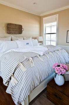 French style farmhouse bedroom with ticking stripe duvet - Im getting this duvet!  Its gorgeous. <3