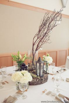 stones to anchor branches  Brooks Scribner Photography Christopher Flowers wedding reception centerpiece manzanita natural lantern white beach