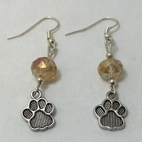 Off White crystal beads and paw print charm earrings. Made with silver plated non tarnish hypoallergenic nickel free materials.