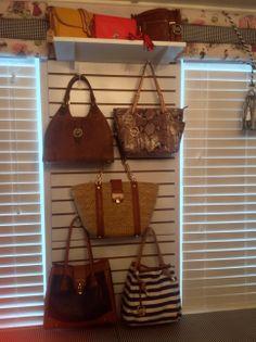 Slat board in closet, Michael Kors bags