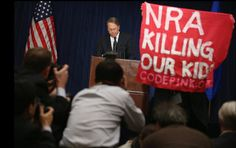 NRA, GTFO   A demonstrator held up a banner as Wayne LaPierre, executive vice president of the National Rifle Association, delivered a statement in Washington on Friday. (Photo: Chip Somodevilla / Getty Images via The New York Times)
