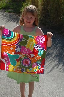 Our Creative Day: Rainbow Batik    You take your Elmers Gel Glue and draw a design all over your fabric. Let is sit and dry for a couple of hours, we set ours in the sunshine. Then you paint your design with acrylic paint - rainbow colors for us....