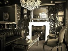 fireplace + chandelier + tufted sofa + damask wallpaper