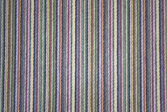 Liage Wool Stripe Fabric A thinly striped wool in multicolours of green, blue, yellow, grey, burgundy and white.