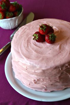 Strawberry Cheesecake Cake Recipe (strawberry cake with a layer of cheesecake in the middle... then covered with strawberry buttercream frosting).
