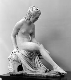 Bather by Jean-Antoine Houdon - Date: 1782 - Digitized: 2012 at the Metropolitan Museum of Art. Jean-Antoine Houdon  (1741 – 1828) was a French neoclassical sculptor.  Houdon is famous for his portrait busts and statues of philosophers, inventors and political figures of the Enlightenment