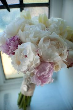 White flowers with purple accents - bridal bouquet for a #wedding #weddingdayflowers