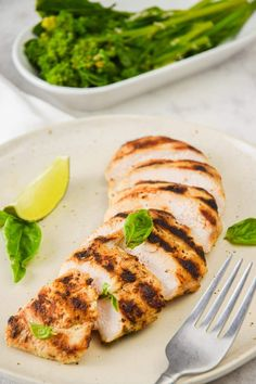This flavor packed grilled chicken marinated in lime juice and fresh basil is bursting with flavor and comes out perfectly tender every time. This healthy recipe from Slender Kitchen is MyWW SmartPoints compliant and is gluten free, low carb, paleo and Whole30. #dinner #kidfriendly #quickandeasy Lime Chicken, Marinated Chicken, Grilled Chicken, Healthy Eating Recipes, Lunch Recipes, Food Dishes, Main Dishes, Slender Kitchen, Weight Watchers Meals