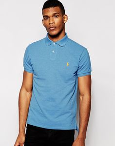 "Polo shirt by Polo Ralph Lauren Cotton mesh pique Ribbed collar and cuffs Embroidered polo player Uneven vented hem Regular fit - true to size Machine wash 100% Cotton Our model wears a size Medium and is 188cm/6'2"" tall"