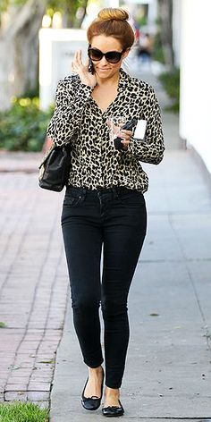 LAUREN CONRAD  Instead of wearing your standard solid-colored button-up to work tomorrow, sub in an on-trend animal-print version. Lauren (in C. Wonder) shows the perfect way to pull it off: with dark jeans (or slim trousers), chic flats and a cute high bun.
