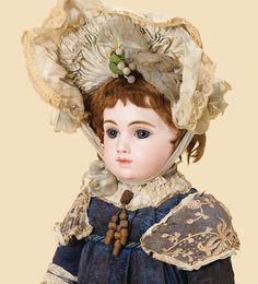 AT I remember this doll so well, It belonged to a Parisian antique doll dealer in the 1980s. It came for sale at the wrong moment for me... How great to see its image again. I understand it is in a Japanese collection now. Lucky owner!