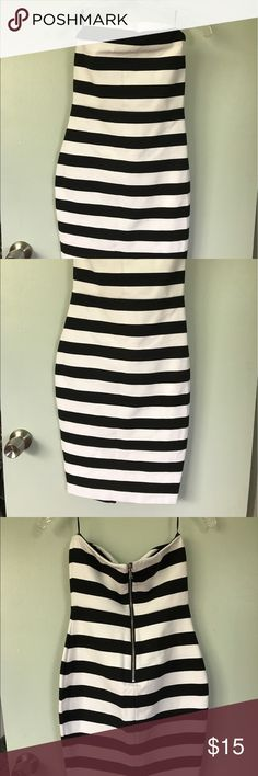 """Fitted B&W Dress Strapless. Fitted. Flattering stripes. Zipper and slit in the back are super sexy. This dress is sexy, but long, I am 5'3"""" and it hit below my knee. Rubber grip around the top keeps the dress from falling down. Express Dresses Strapless"""