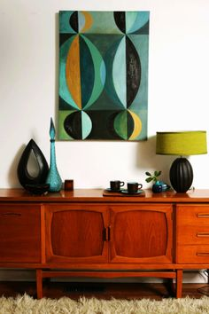 Midcentury modern art details and gorgeous wood cabinet