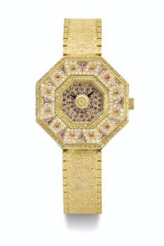 BUCCELLATI A LIMITED EDITION LADY'S YELLOW GOLD, DIAMOND, RUBY AND AMETHYST OCTAGONAL BRACELET WATCH CIRCA 2011 OKTACHRON • quartz movement •  gilt dial set with amethyst, black arrow hands • 18k yellow gold octagonal case, wide bezel set with diamonds, amethyst and rubies, polished and decorated case band • 18k yellow gold integrated patterned bracelet with twin folding clasp • case, dial, movement and clasp signed.