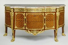 Commode (Getty Museum)Gilles Joubert  French, Paris, 1769  Oak veneered with kingwood, tulipwood, holly, satiné (bloodwood), and ebony; gilt bronze mounts; sarrancolin des Pyrenées marble top  3 ft. 13/16 in. x 5 ft. 11 1/4 in. x 2 ft. 3 in.