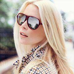 Claudia Schiffer wearing  sunglasses model 'Cherry' from her Claudia Schiffer by Rodenstock Collection.