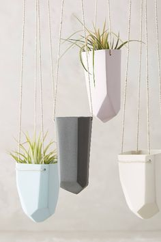 Faceted ceramic hanging planters - they look like gems. Love the simple, organic feel. Perfect for plant lovers and rock collectors