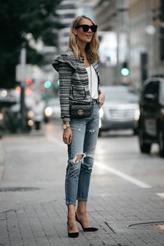 aeeb5e354101 Blonde Woman Wearing Club Monaco Tweed Jacket Denim Ripped Jeans Gucci Mini  Marmont Handbag Black Pumps