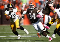 Troy Polamalu Photos - Isaiah Crowell #34 of the Cleveland Browns carries the ball in front of Troy Polamalu #43 of the Pittsburgh Steelers during the second quarter at FirstEnergy Stadium on October 12, 2014 in Cleveland, Ohio. - Pittsburgh Steelers v Cleveland Browns