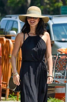 Olivia Munn wears black in downtown.. Do you like her dress?