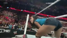 aj lee ass photos | AJ LEE looking at kaitlyn who is sitting at the announce table on raw ...