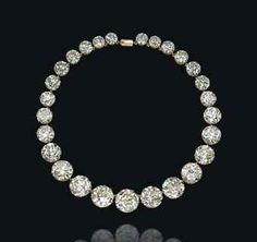 A DIAMOND RIVIÈRE NECKLACE Set with twenty-seven graduated circular-cut diamonds, mounted in gold totaling 131.11 carats.