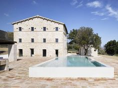 vintage homes in Italy | Italian House Renovation concrete and stone exterior Renovated House ...