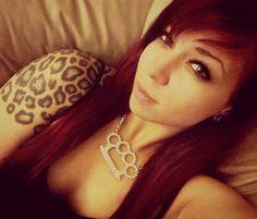 Animal print tattoo, tattooed females, leopard print, parent, red hair,