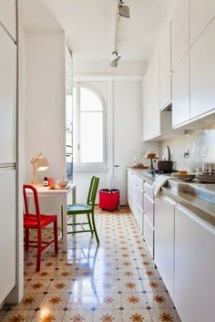 white kitchen + patterned floor