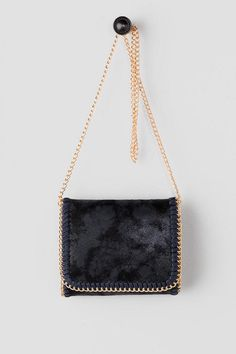 """The Draper Distressed Crossbody is a must-have this season! Distressed deep navy material has a unique shine to it and is accented by a navy whipstitch detail & gold chain. Finished with a magnetic closure, inside pockets & an optional crossbody chain.<br /> <br /> - 8"""" length x 7"""" height x 2"""" width<br /> - 25"""" optional shoulder strap drop<br /> - Imported"""
