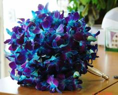 Blue orchid bridal bouquet, this is incredibly beautiful for a navy and violet bridesmaid bouquet