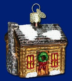 """Item 20015 Log Cabin 2.5"""" tall. Many years ago, log cabins provided shelter on the American Frontier as settlers moved west. In fact, our 16th President, """"Honest Abe"""" Lincoln, was raised in a log cabin. Today, the Log Cabin ornament represents the pioneer spirit, hard work, and the pleasures of the simple life. #oldworldchristmas #theamericanway #logcabin"""