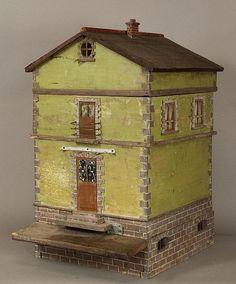 Rare European bee skep in the form of a house. Bees enter below door stoop