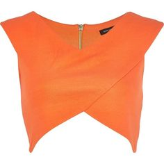 Rock the hottest crop in this orange wrap front crop top. Featuring zip back fastening, V neck and cap sleeves.