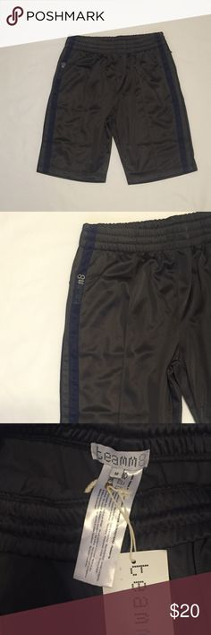 NWT! Teamm8 dark grey Medium gym shorts NWT! Teamm8 dark grey gym shorts with navy blue strips. Elastic waist with draw string. Zip up pockets on each side. Waist 16in flat LT 20in 100% polyester. Comes from pet and smoke free home. Teamm8 Shorts Athletic